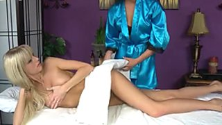 A couple of hot fair haired lesbians present steamy sex in massage parlor
