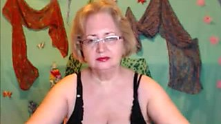 Busty mature with glasses masturbating